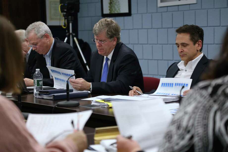 Before the pandemic changed everything, Board of Finance members Jeff Rutishauser, Michael Kaelin and Stewart Koenigsberg look over Board of Education documents on Feb. 6. Photo: Jarret Liotta / Hearst Connecticut Media / Wilton Bulletin