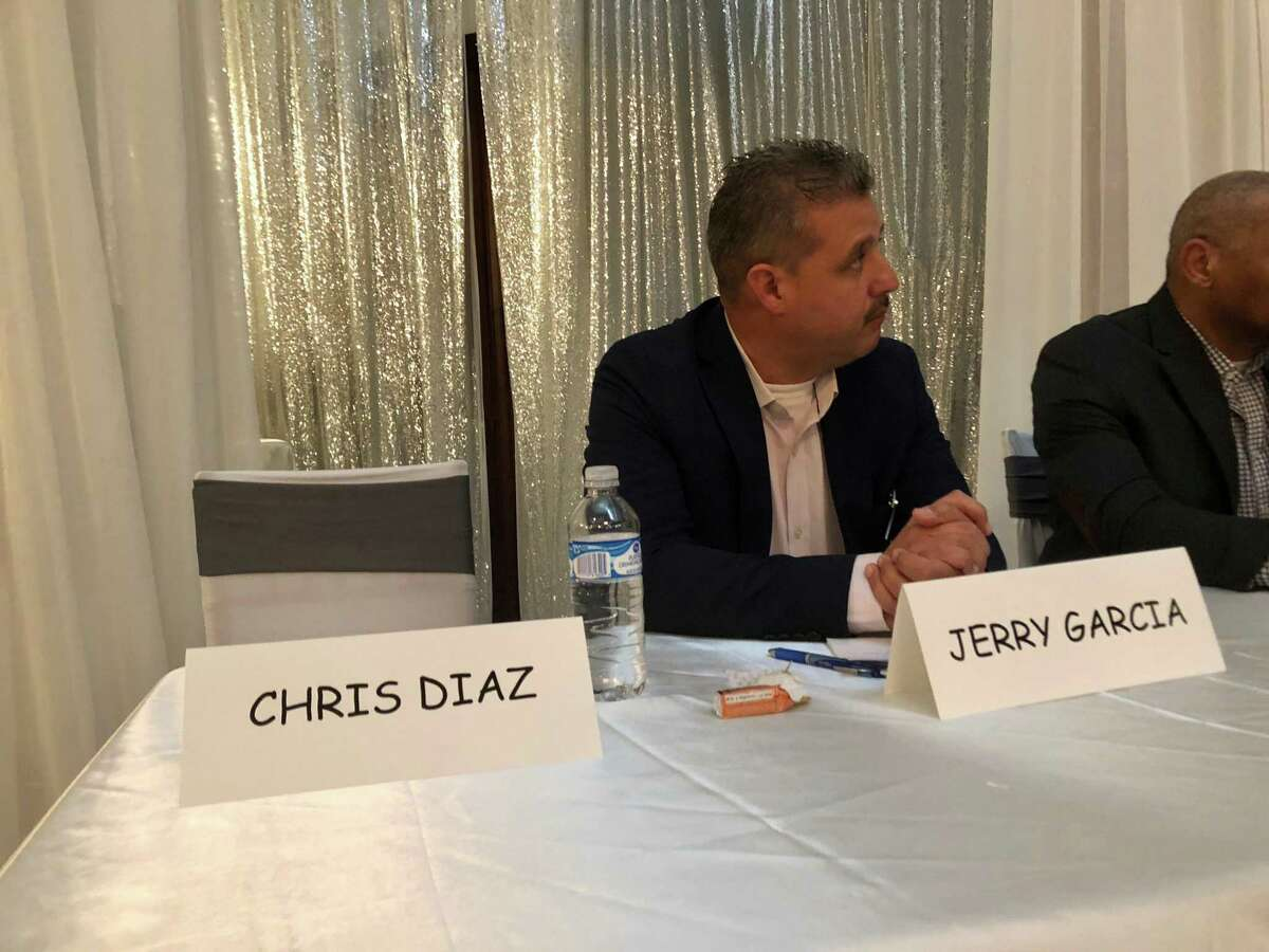 A placard marks a reserved seat for Precinct 2 Constable Chris Diaz, who skipped a candidate forum on Feb. 12, 2020. Jerry Garcia is one of the candidates challenging Diaz in the Democratic Party primary.