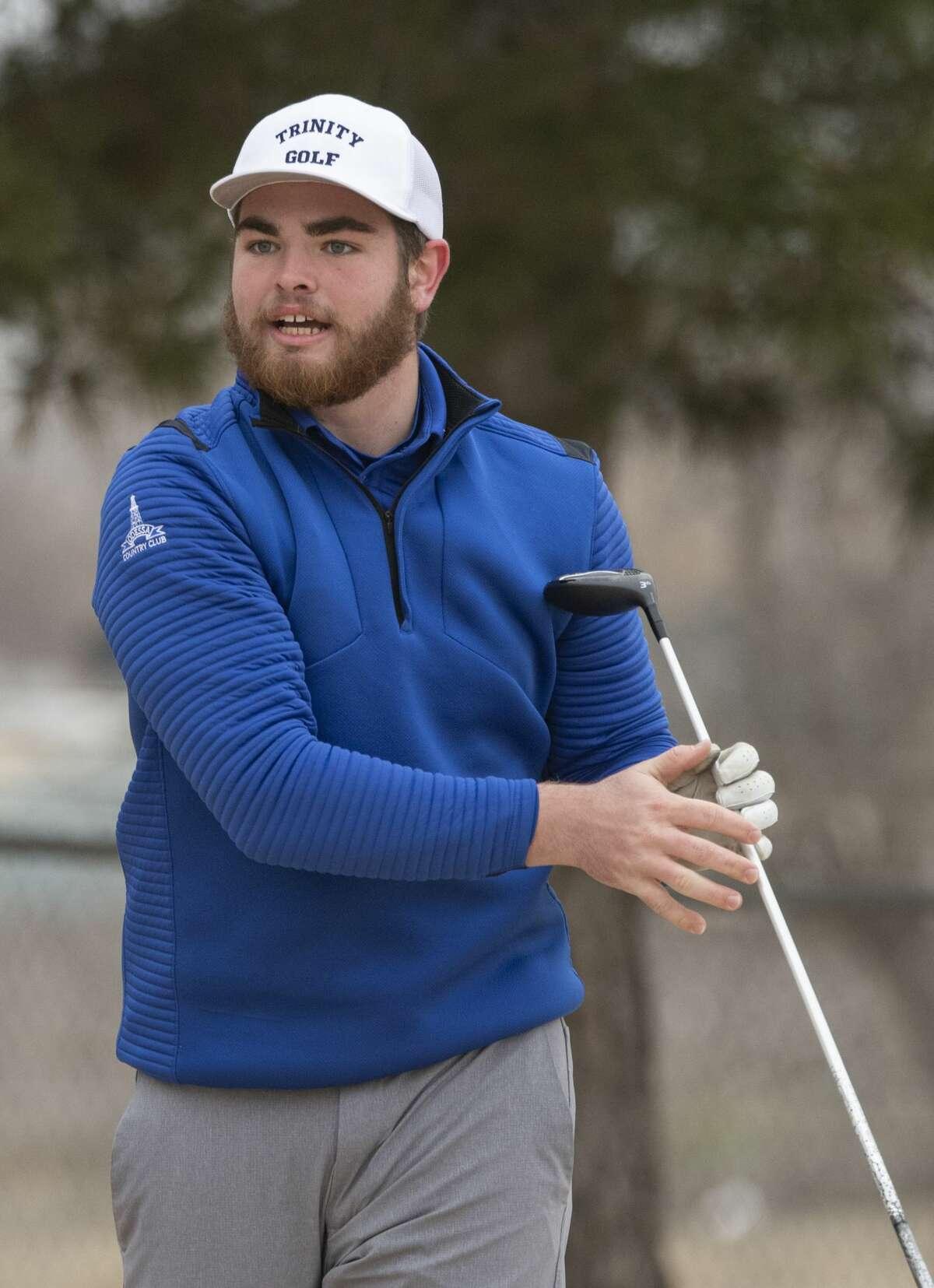 Trinity's Davis Seybert follows tee shot 02/14/2020 on the first day of the Tall City Boys Invitational at Ranchland Hills Golf Club. Tim Fischer/Reporter-Telegram