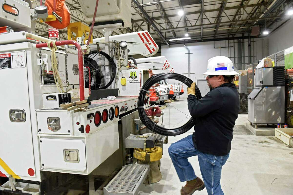 Ray Burlett, chief line mechanic hotstick for National Grid, stocks a truck in the truck barn at National Grid on Friday, Feb. 14, 2020 in Queensbury, N.Y. More New Yorkers have fallen behind on their utility bills in the wake of the pandemic. (Lori Van Buren/Times Union)