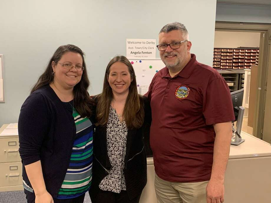 Angela Fenton, left, and Stacy Casini, center, with Derby Town/City Clerk Marc Garofalo. Fenton and Casini were hired as the city's two new assistant town/city clerks filling vacancies in that office. Photo: / Michael P. Mayko
