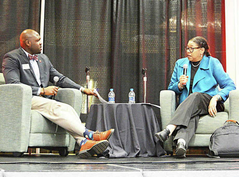 Prince Robertson, left, assistant director of student conduct at SIUE, talks to Dr. Robin Hughes, dean of the SIUE School of Education, Health and Human Behavior, during the opening ceremony for Black Heritage Month on Feb. 3 at the Goshen Lounge at the Morris University Center. Photo: Scott Marion|The Intelligencer