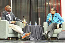Prince Robertson, left, assistant director of student conduct at SIUE, talks to Dr. Robin Hughes, dean of the SIUE School of Education, Health and Human Behavior, during the opening ceremony for Black Heritage Month on Feb. 3 at the Goshen Lounge at the Morris University Center.