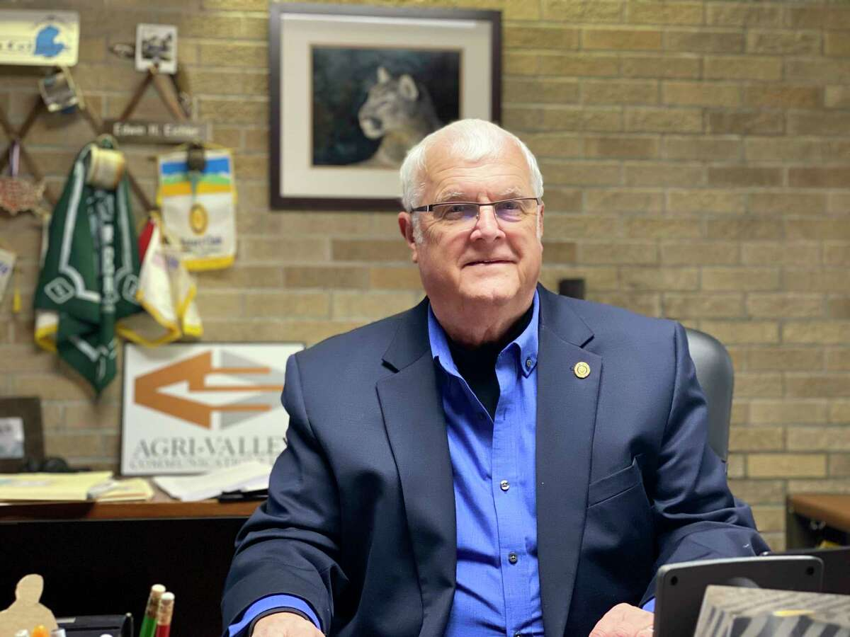 Edwin Eichler poses for a photo at his desk in his Agri-Valley Communications office. (Submitted Photo)