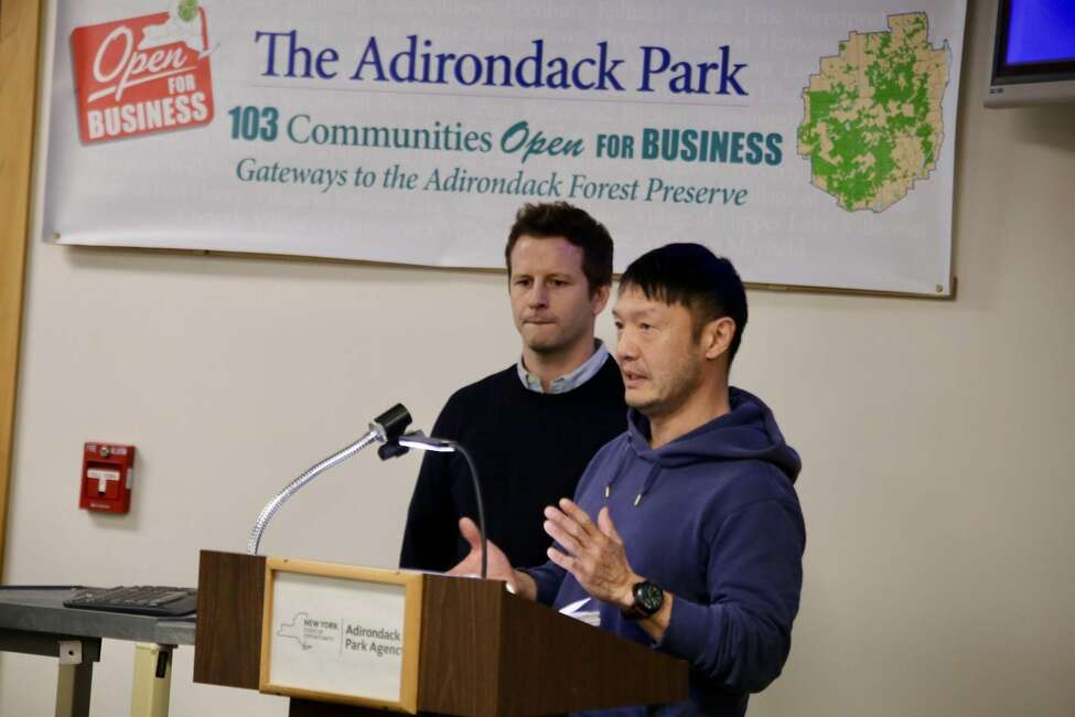 James John McDonald and Jeffrey Lee testify on Thursday during an enforcement hearing at the Adirondack Park Agency's meeting in Ray Brook. (Gwendolyn Craig)