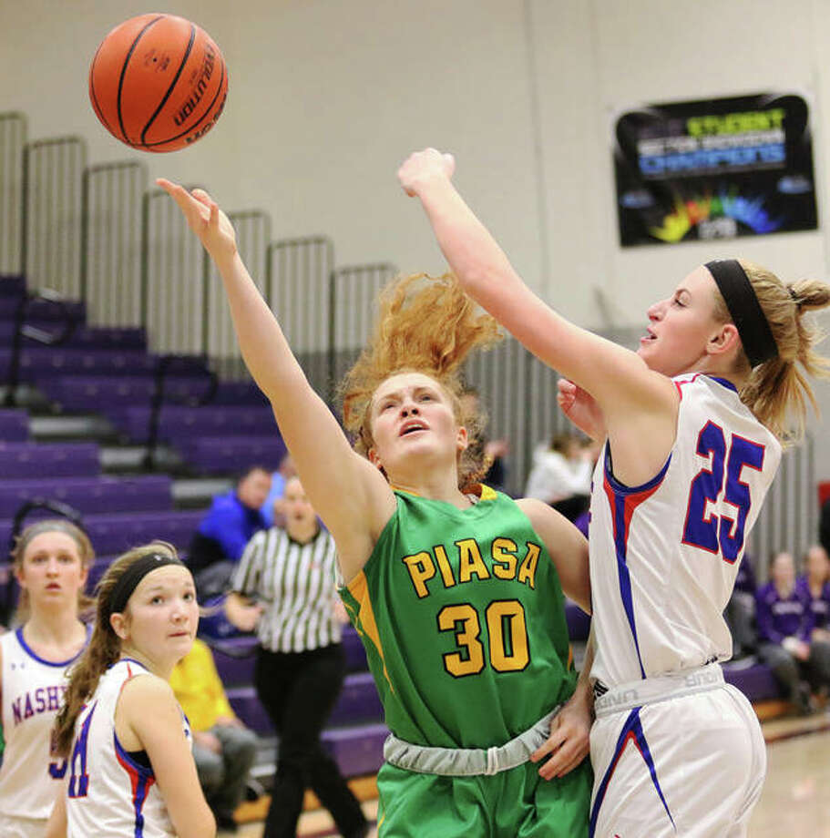 Southwestern's Rylee Smith (30), shown putting up a shot over Nashville's Rylee Luechtefeld at the Breese Central Shootout on Jan. 4, scored 16 points to lead the Piasa Birds in Thursday's loss to Breese Central in the title game of the Carlyle Class 2A Regional. Photo: Greg Shashack / The Telegraph