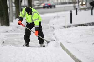 A worker clears the sidewalks in front of 1055 Washington Blvd. following a winter storm on Jan. 18 in Stamford that left travelers with slippery conditions and 1-2 inches of snow. It was one of the few snowstorms of this winter.