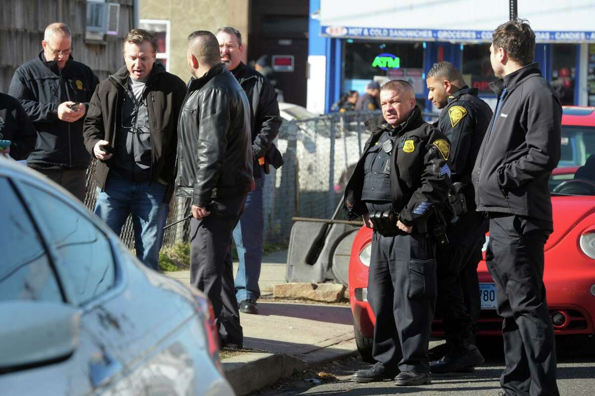 Bridgeport Police investigate the scene around the intersection of Kossuth and Jane Streets where a man was shot to death in Bridgeport, Conn. Feb. 14, 2020.