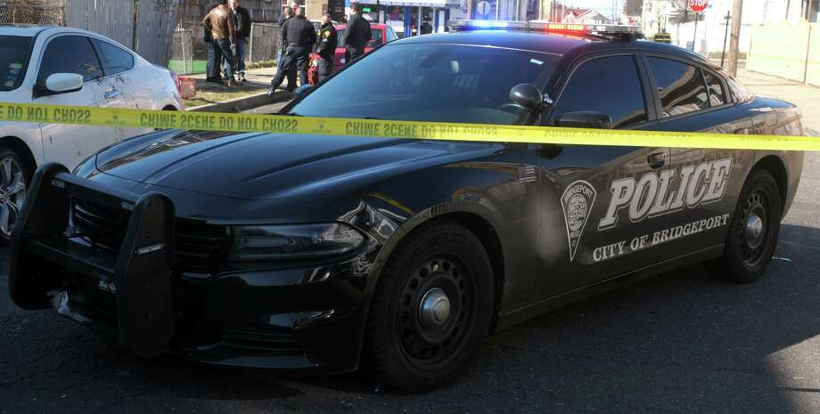 File photo of a Bridgeport, Conn., police cruiser at a crime scene. Photo: Ned Gerard / Hearst Connecticut Media / Connecticut Post