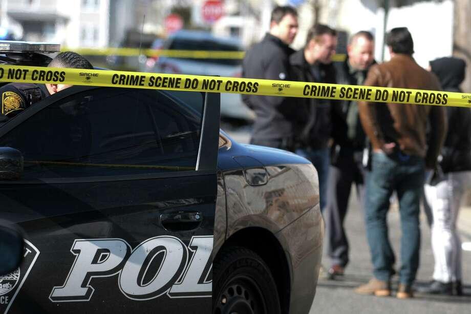 File photo of Bridgeport, Conn., police investigating a crime scene. Photo: Ned Gerard / Hearst Connecticut Media / Connecticut Post