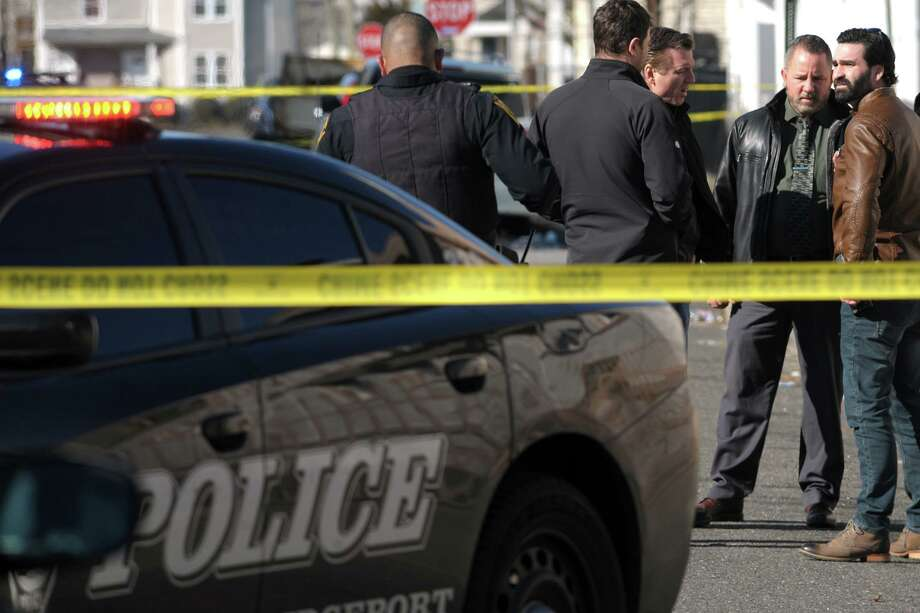 Bridgeport Police investigate the scene around the intersection of Kossuth and Jane Streets where a man was shot to death in Bridgeport, Conn. Feb. 14, 2020. Photo: Ned Gerard / Hearst Connecticut Media / Connecticut Post