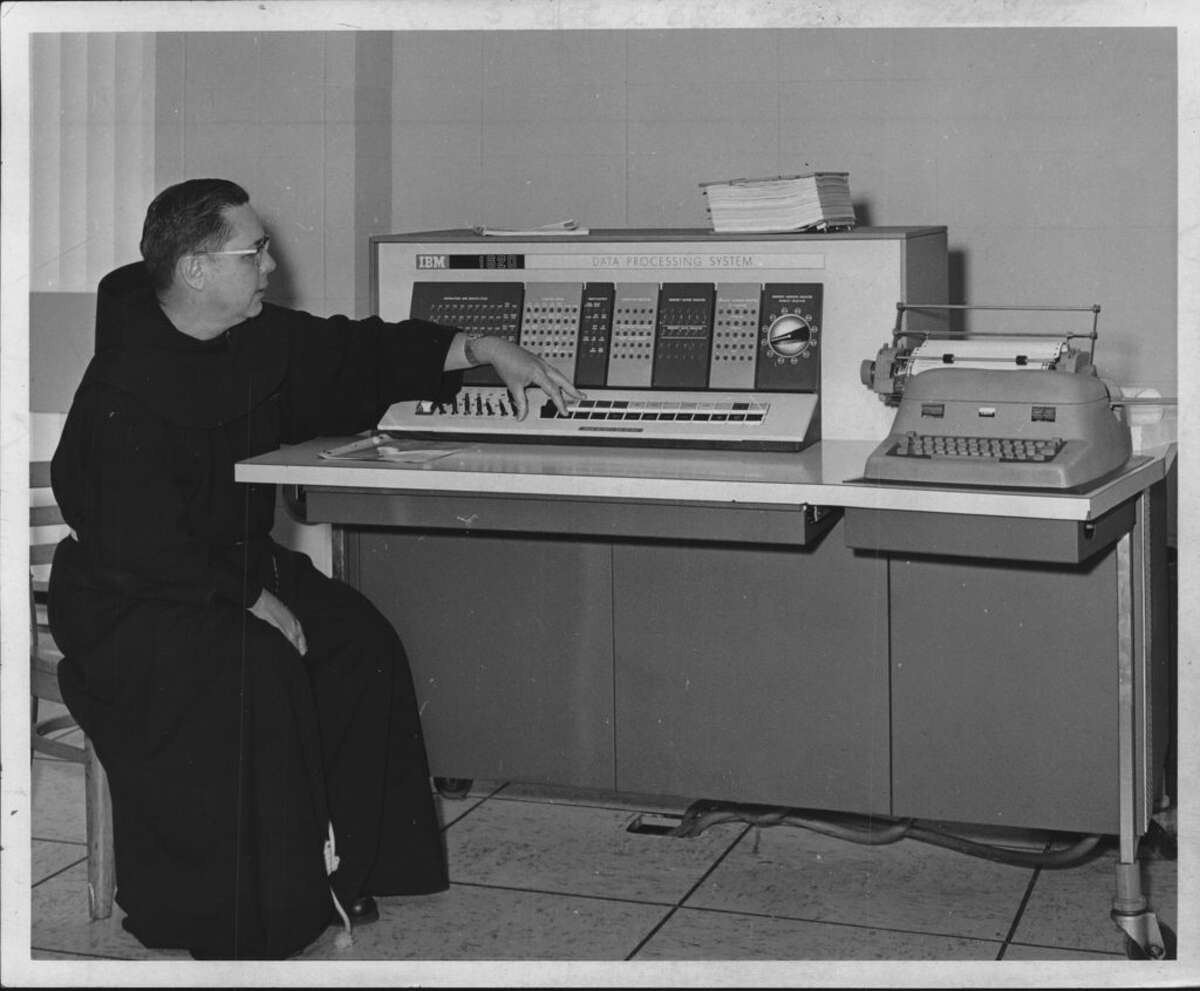 The Rev. Laurence Rainville works the IBM 1620 data processing system in Siena College's new computer laboratory in Roger Bacon Hall on the campus in Loudonville in 1967. The computer was used for all programming instruction and was also available to professors of the science division for research work. Students who completed the programming course were also free to use the computer.