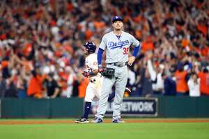 HOUSTON, TX - OCTOBER 29: Cody Bellinger #35 of the Los Angeles Dodgers reacts as Jose Altuve #27 of the Houston Astros rounds the bases after hitting a three-run home run in the fifth inning of Game 5 of the 2017 World Series at Minute Maid Park on Sunday, October 29, 2017 in Houston, Texas. (Photo by Rob Tringali/MLB via Getty Images)