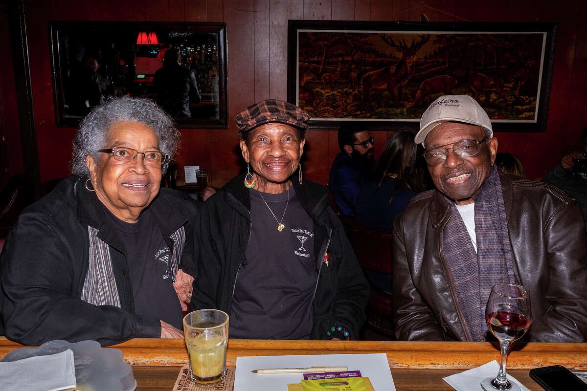 Laura Mason, Bealo Hall and Rudy N. Smith (from left to right) sitting at the bar of The Page. The trio is part of a group that comes in every week called the Wednesday crew.