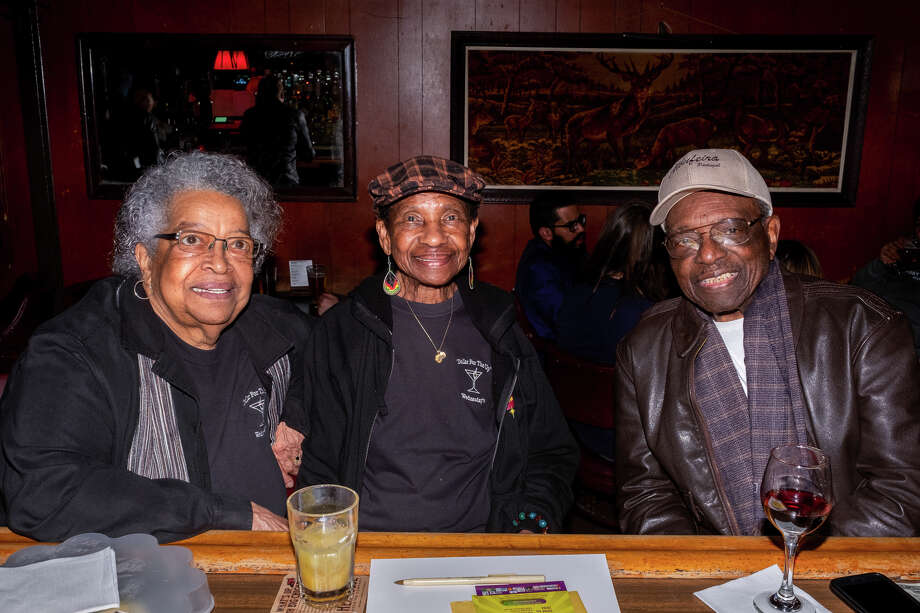 Laura Mason, Bealo Hall and Rudy N. Smith (from left to right) sitting at the bar of The Page. The trio is part of a group that comes in every week called the Wednesday crew. Photo: Alexander Nicholson