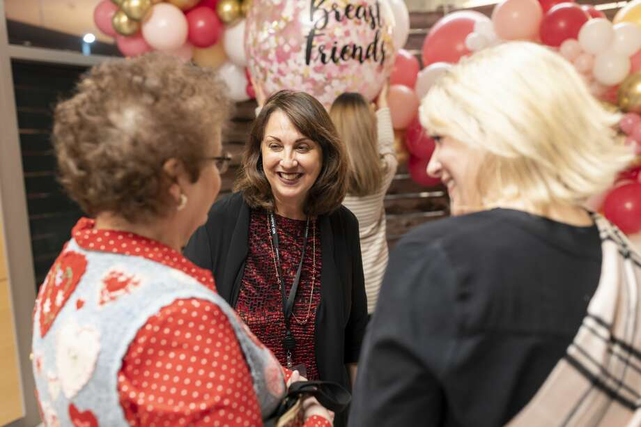 Dr. Schlembach (middle), speaks with Brenda Broussard (left) and Coleen Skipper during Pamper Me Night at MD Anderson The Woodlands, Wednesday, Feb. 12, 2020. The Breast Friends group which hosts the event is led by Dr. Schlembach. Photo: Gustavo Huerta/Staff Photographer