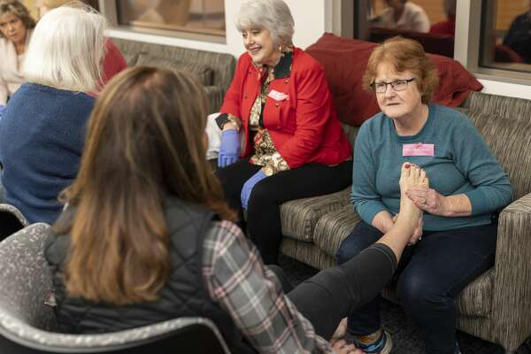 Dona Williams, massages the feet of cancer patients and survivors during Pamper Me Night at MD Anderson The Woodlands, Wednesday, Feb. 12, 2020. Survivors and patients were able to partake in various spa and wellness activities.
