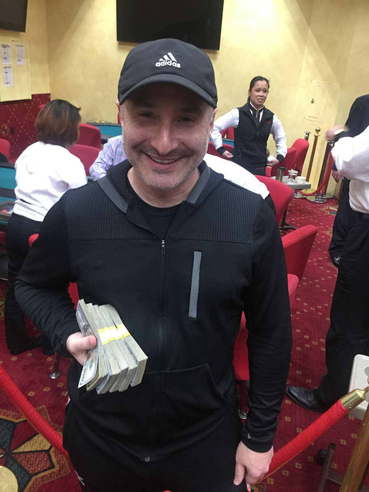 San Francisco tech executive recruiter and amateur poker player Doug Gladstone is shown with his winnings at the Deep Stack Texas Hold 'Em tournament at the Venetian Resort in Las Vegas.