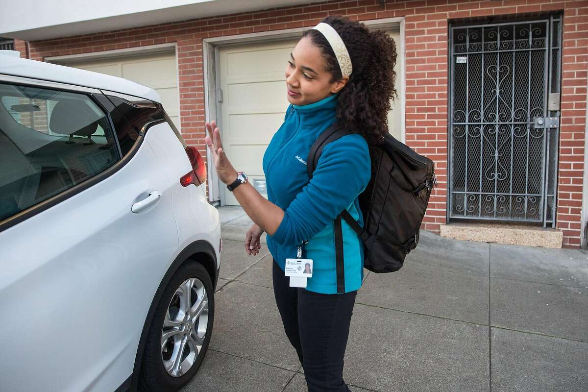 Katrina Griffith, physical therapist with Sutter Care at Home, greets Lyft driver, James Greenblat, before she gets in the car to go visit a Sutter client on Wednesday morning, February 5, 2020. San Francisco, Calif.