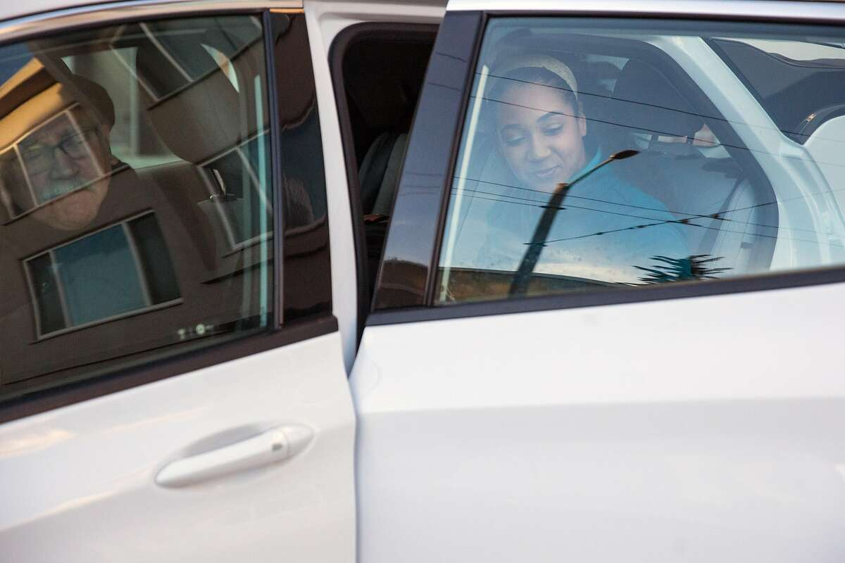Lyft driver, James Greenblat, arrives to pick up Katrina Griffith, physical therapist with Sutter Care at Home, to take her to visit Sutter client on Wednesday morning, February 5, 2020. San Francisco, Calif.