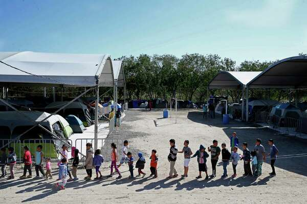 Children play at the migrant camp, which is the temporary home to more than 2,500 people, mostly from Central America.