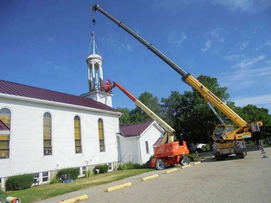 To get ready for the milestone 150 year anniversary celebration Sunday, a new steeple was put in place on the top of the Moravian Church at 2711 Cass St. in Unionville. (Submitted Photo)