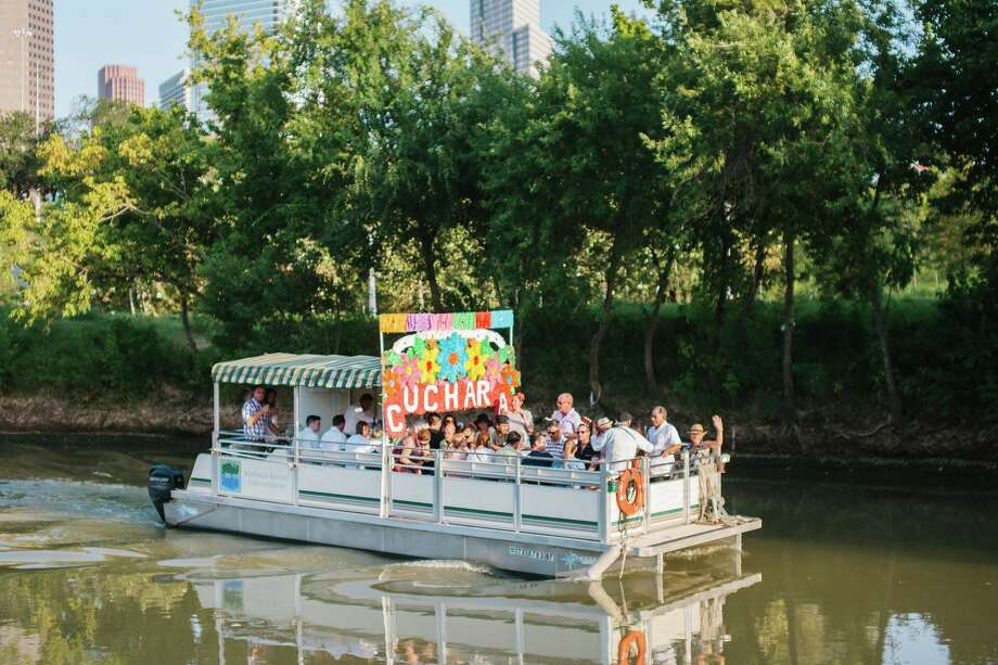 Cuchara Restaurant's Xochimilco boat tours run for an hour and a half down Houston's Buffalo Bayou and come with endless margaritas, ceviche and live music from a trio band that plays music from Mexico dating as far back as the 50s and 60s. Photo: Courtesy Cuchara Restaurant