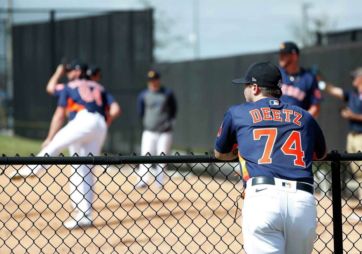 Houston Astros pitcher Dean Deetz (74) watches other pitchers throw off the mound during the second day of the Houston Astros spring training workouts at the Fitteam Ballpark of The Palm Beaches, in West Palm Beach , Friday, Feb. 14, 2020.