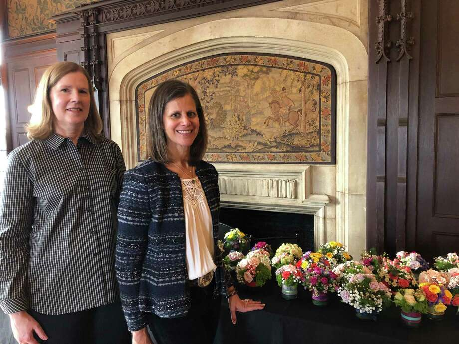 At a recent meeting of the New Canaan Garden Club, members gathered to create small Valentine's Day arrangements which were delivered to friends, and former Garden Club members at the Waveny Care Center, The Inn at Waveny, Atria and Meals on Wheels. Pictured with the valentine arrangements are Mary Tanzi, and Debbie Gordon, co-chairs of the club's Floral Design activity committee. Photo: Contributed Photo