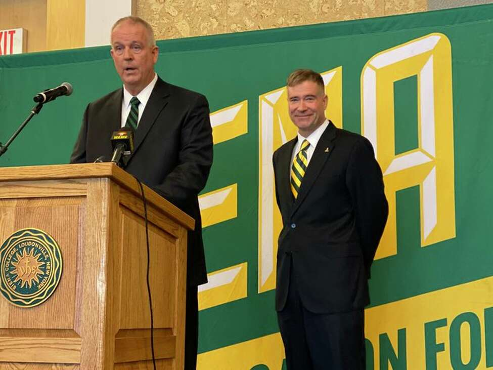 Former U.S. Rep. Chris Gibson, right, is announced as the next president of Siena College on Friday, Feb. 14, 2020.