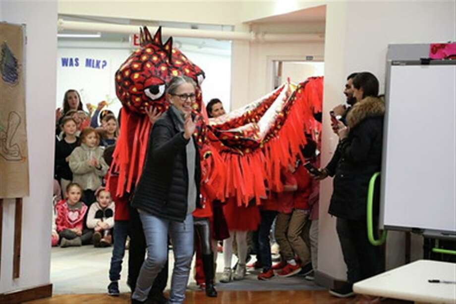 New Canaan Country School students made a papier-mâché dragon in art class under the direction of visual arts teacher Liz Ferran, which they paraded through the school's Lower School halls in celebration of the Lunar New Year. Photo: Contributed Photo