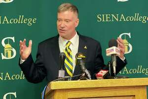 Former U.S. Rep. Chris Gibson speaks to reporters after Siena College introduced him Friday as the Loudonville college's next president.