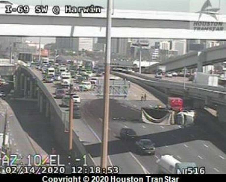 An overturned dump truck delayed traffic on the southbound Southwest Freeway on Friday, Feb. 14, 2020. Photo: Houston Transtar