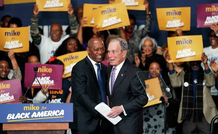 """Democratic presidential candidate and former New York City Mayor Michael Bloomberg, right, is introduced by Houston Mayor Sylvester Turner during his campaign launch of """"Mike for Black America,"""" at the Buffalo Soldiers National Museum, Thursday, Feb. 13, 2020, in Houston. (AP Photo/David J. Phillip)"""