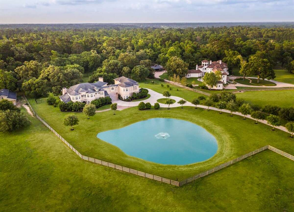 This country, equestrian paradise was recently listed at $2.5 million and is just 35 minutes from downtown Houston. Hidden behind clusters of live oaks and rolling hills, this 7,503-square-foot Hockley home boasts seven bedrooms, eight full and two half bathrooms, game room, cinema, guest apartment, summer kitchen, vanishing edge pool and a fully-lighted barn with tack room.