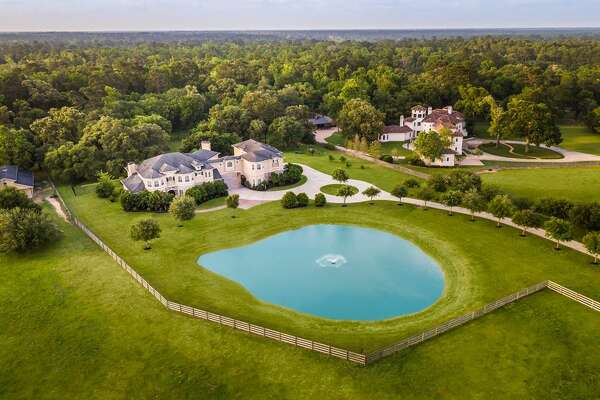 This country, equestrian paradise was recently listed at $2.5 million is just 35 minutes from downtown Houston. Hidden behind clusters of live oaks and rolling hills, this 7,503-square-foot Hockley home boasts seven bedrooms, eight full and two half bathrooms, game room, cinema, guest apartment, summer kitchen, vanishing edge pool and a fully-lighted barn with tack room.