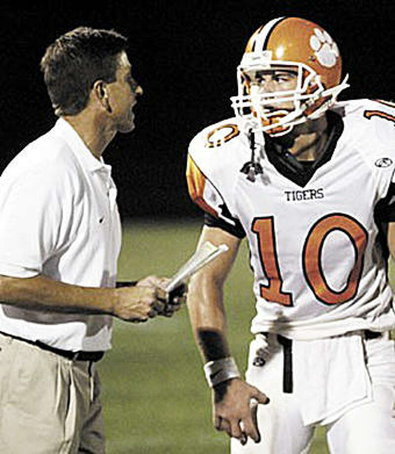 Former Edwardsville coach Tim Dougherty, left, talks to EHS quarterback Joe Allaria during a game in 2006. Dougherty, who was the head coach at EHS from 1992 to 2007, is currently an assistant coach and defensive coordinator at Hamilton High School in Chandler, Arizona. Photo: For The Intelligencer