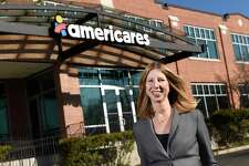 Incoming Americares President and CEO Christine Squires poses at the Americares headquarters at 88 Hamilton Ave., in Stamford, Conn., on Wednesday, Jan. 29, 2020. Squires is currently the company's executive vice president and chief development officer and will succeed Michael J. Nyenhuis, who is leaving in March to become president and CEO of UNICEF USA.