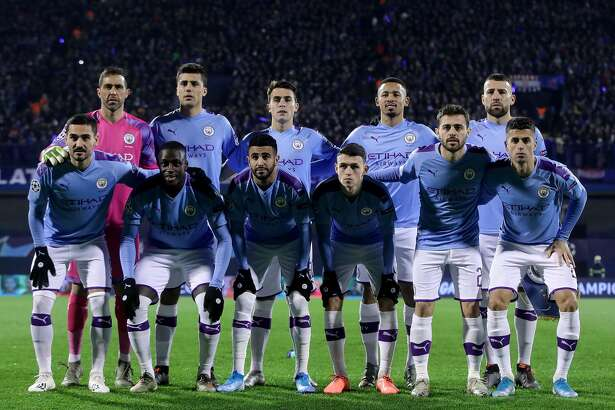 ZAGREB, CROATIA - DECEMBER 11: Manchester City players pose for a team photo prior the UEFA Champions League group C match between Dinamo Zagreb and Manchester City at Maksimir Stadium on December 11, 2019 in Zagreb, Croatia. (Photo by Goran Stanzl/Pixsell/MB Media/Getty Images)