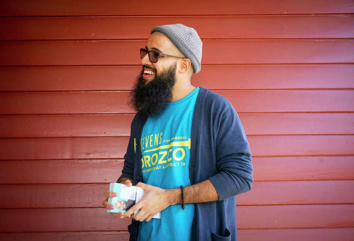 Stevens Orozco talks with a resident as he campaigns door to door, Saturday, Feb. 8, 2020, in Houston's Heights area. Orozco is one of six candidates challenging Congresswoman Sheila Jackson Lee in the upcoming democratic primary.