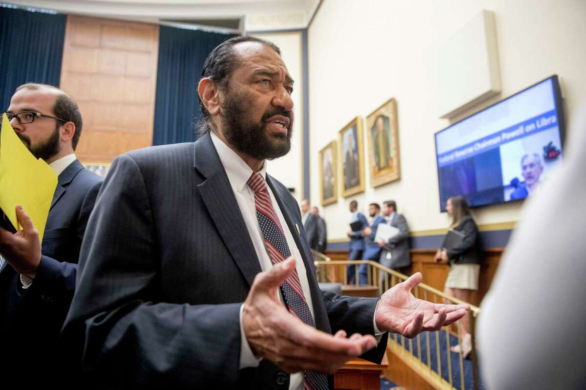 Rep. Al Green, D-Texas, right, speaks to visitors during a break from testimony from David Marcus, CEO of Facebook's Calibra digital wallet service, before a House Financial Services Committee hearing on Facebook's proposed cryptocurrency on Capitol Hill in Washington, Wednesday, July 17, 2019. Green has introduced a resolution in the House to impeach President Donald Trump. (AP Photo/Andrew Harnik)