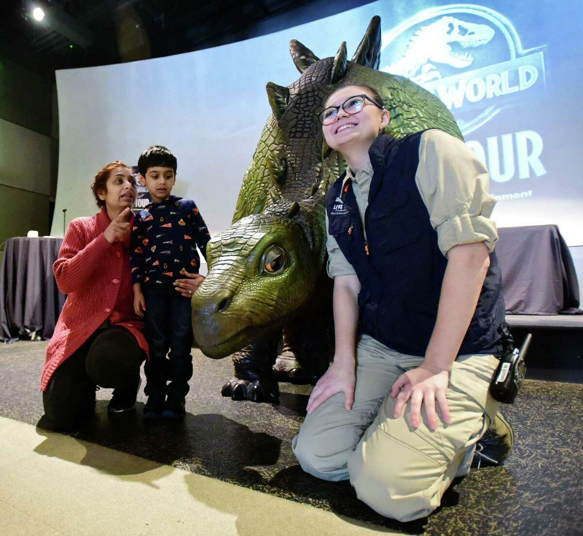 Steph Warrington of Feld Entertainment, right, poses with Anandi Patel of Norwalk and her son, Samanth Patel, 4, as Feld presents Jurassic World Live Tour event featuring Olive the animatronic baby Stegosaurus Friday, February 14, 2020, at Stepping Stones Museum for Children in Norwalk, Conn.