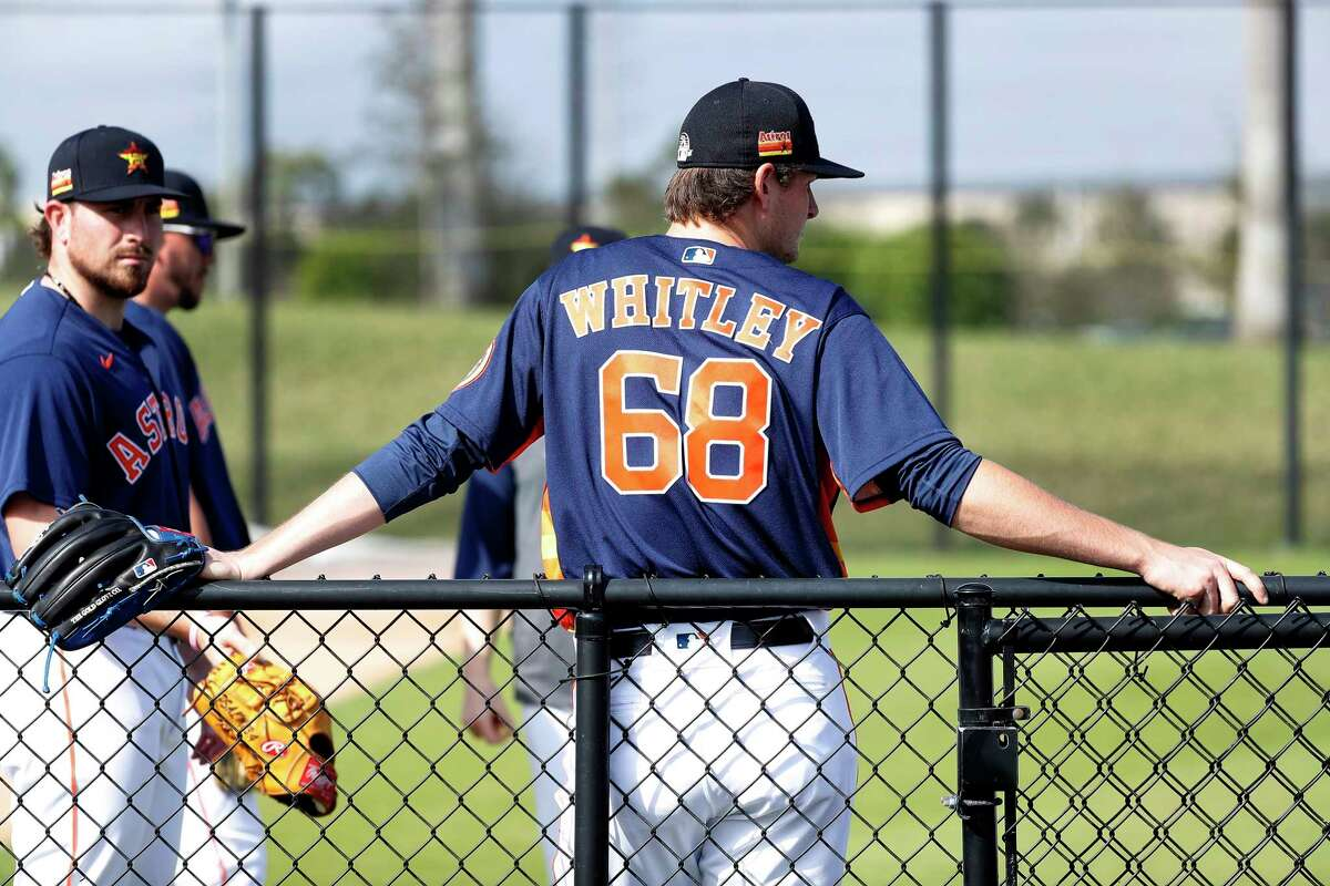 Houston Astros pitcher Forrest Whitley (68) leans against a fence during the second day of the Houston Astros spring training workouts at the Fitteam Ballpark of The Palm Beaches, in West Palm Beach , Friday, Feb. 14, 2020.