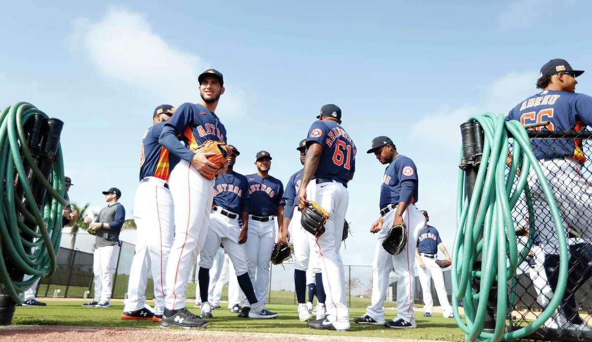 Houston Astros pitcher Cionel Perez (52) with the other pitchers waiting to start the day during the second day of the Houston Astros spring training workouts at the Fitteam Ballpark of The Palm Beaches, in West Palm Beach , Friday, Feb. 14, 2020.