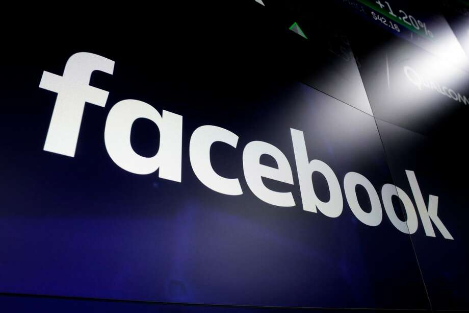 FILE - In this March 29, 2018 file photo shows the logo for Facebook at the Nasdaq MarketSite, in New York's Times Square. The social media company is one of many who are allowing their employees to work from home in the wake of coronavirus cases sprouting around the Bay Area. Photo: Richard Drew, Associated Press
