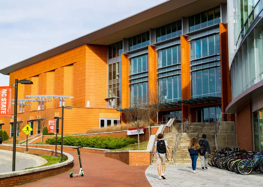 #49. North Carolina State University - Tuition: $14,610 (out-of-state); $4,550 (in-state, #2 least expensive) - Location: Raleigh, North Carolina - Students: 21,384 (student-to-faculty ratio: 13:1) - Acceptance rate: 51% (ACT: 26-31; SAT: 1230-1390) - Outcomes: graduation rate: 79%; six-year median earnings: $52,500 With Business, Biology, Agricultural Science, and Engineering as some of its strongest and most popular majors, North Carolina State University was ranked by US News & World Report as #34 on the list of Top Public Schools in America. As of 2019, undergraduates made up more than two-thirds of the total student presence on campus, and 80% of students came from in-state. Fun fact: NCSU students often take part in the annual