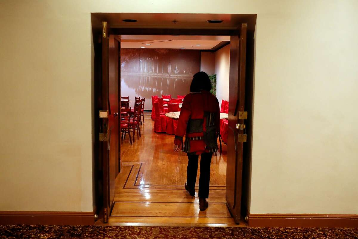 Tatwina Lee of Chinese Culture Foundation enters a small banquet room at Far East Cafe in San Francisco, Calif., on Thursday, February 13, 2020.