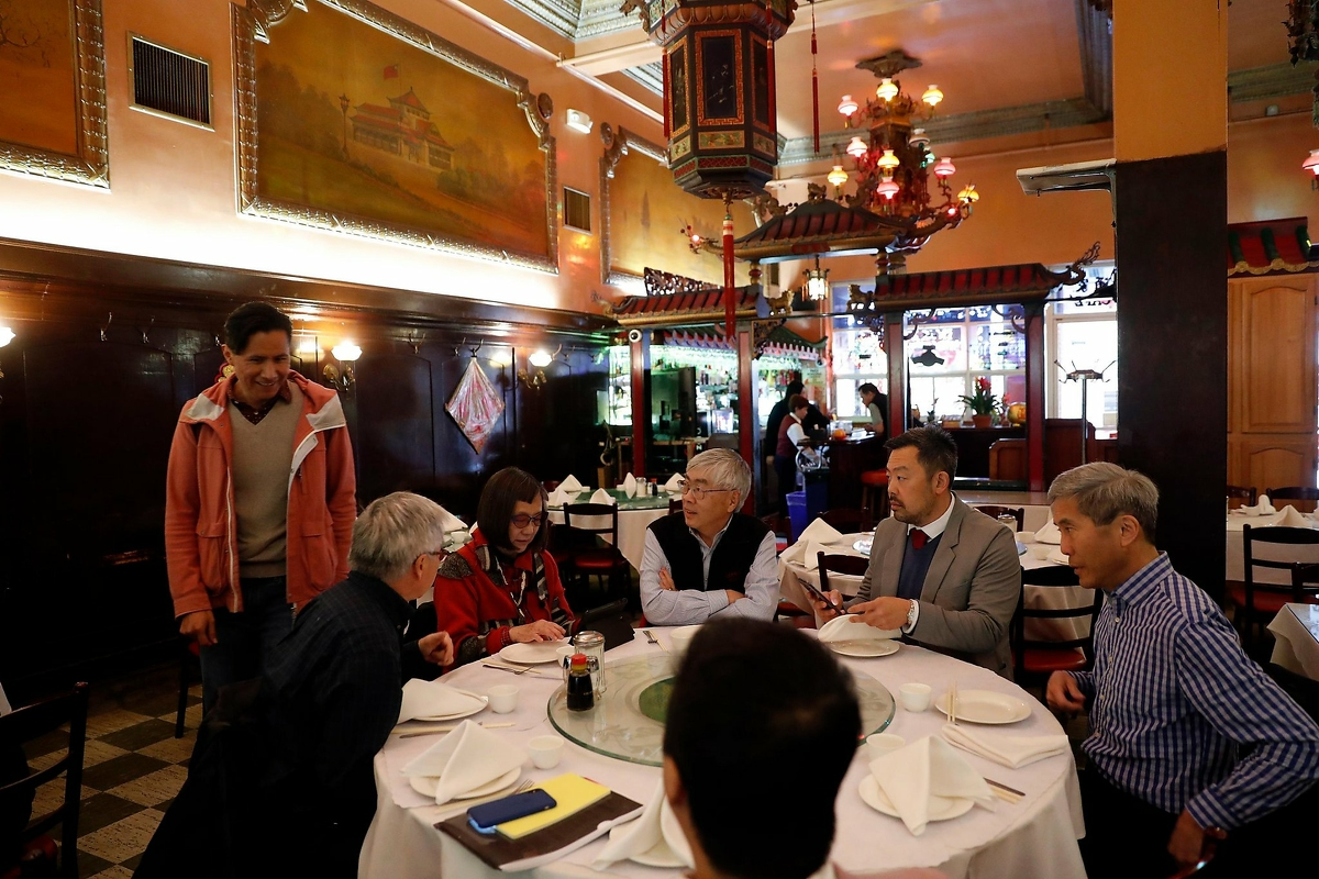 Malcolm Yeung of Chinatown Community Development Center (second from right) readies to lead meeting of Chinatown Arts and Culture Coalition meeting at Far East Cafe in San Francisco, Calif., on Thursday, February 13, 2020.