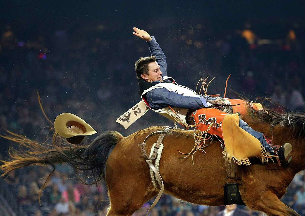 Clayton Bigelow competes in the bareback riding competition during the Houston Livestock Show and Rodeo in NRG Stadium Monday, March 7, 2016, in Houston. ( Mark Mulligan / Houston Chronicle )