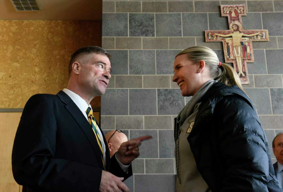 Former U.S. Rep. Chris Gibson talks Siena women's basketball coach Ali Jaques after Siena College announced him as its 12th president at Siena College on Friday, Feb. 14, 2020 in Loudonville, N.Y. Gibson, Ph.D, graduated from Siena in the class of '86. (Lori Van Buren/Times Union)